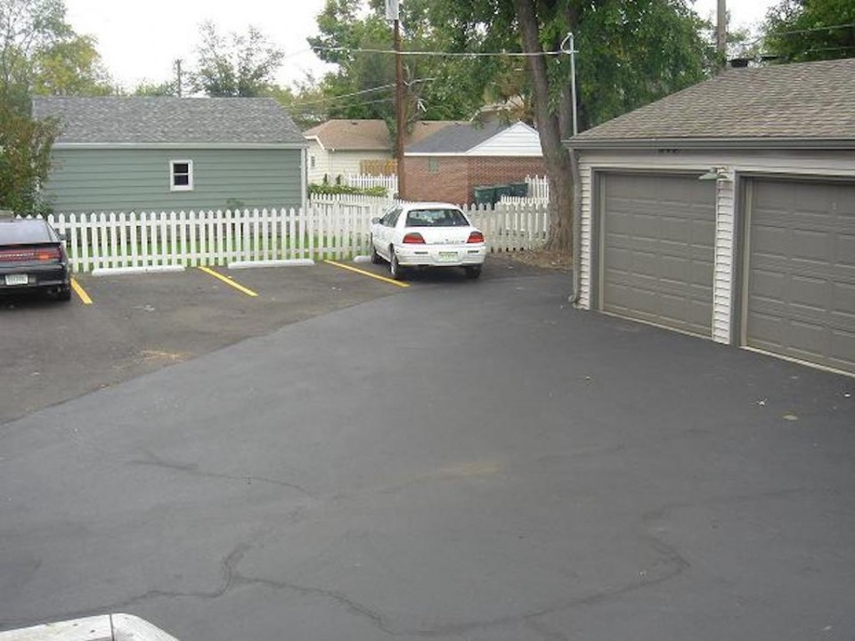 1313 University 6 bedroom Ball State student rental house for rent in muncie parking lot